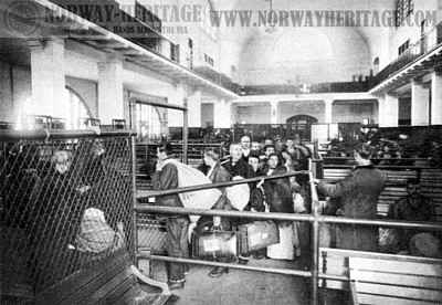 Immigrants filing past the doctors - Ellis Island